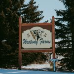 A sign for Westway farms
